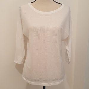 New balance white 3/4 sleeve active shirt.